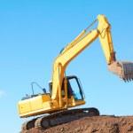 Yellow Excavation Machine On Heap Of Soil — Stock Photo #29919735