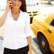 Businesswoman hailing a yellow taxi cab — Stock Photo #29919811