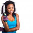 African-American woman holding gardening tool — Stock Photo