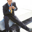 Young Businessman In Rollerblade Adjusting Tie — Stock Photo