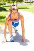 Woman Stretching On Park Footpath — Stock Photo