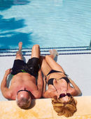 Mature caucasion male and female relaxing in the pool — Stok fotoğraf