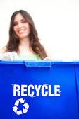 Happy beautiful hispanic female holding recycling bin — Zdjęcie stockowe