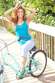 Carefree Woman On Bicycle — Stock Photo