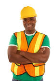 Happy african american construction with arms crossed — Stock Photo