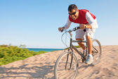 Hispanic male with mountain bike riding downhill — Stock Photo