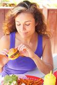 Woman Holding a Mini Burger — Stock Photo