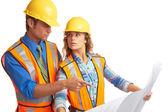 Trabalhadores da construção civil de masculino e feminino atraente olhar azul — Foto Stock