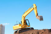 Yellow Excavation Machine On Heap Of Soil — Stock Photo