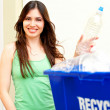 Happy beautiful hispanic female putting water bottle in recycli — Stock Photo