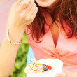 Young Female Eating Ice Cream — Stock Photo
