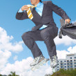 Stock Photo: BusinessmRollerblading With Briefcase