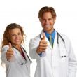 Attractive female and male doctor giving approval — Stock Photo #29920231