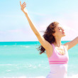 Beautiful happy female enjoying a day at the beach — Stock Photo