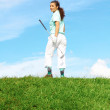 Stock Photo: Happy Pretty Female Golfer Walking Away