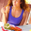 Stock Photo: WomHaving Midday Meal