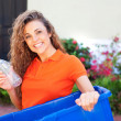 Beautiful female holding recycling bin — Stock Photo