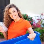 Beautiful female holding recycling bin — Stock Photo #29920449