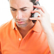 Sad male talking on cellphone — Stock Photo
