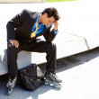 Stock Photo: Tensed Young BusinessmIn Rollerblade
