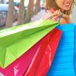 Young Woman With Multi Colored Shopping Bags — Foto de Stock
