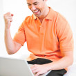Happy work at home male working on laptop smiling — Stock Photo