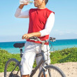 Hispanic Man Taking a Break From Biking Quenching His Thirst — Stock Photo #29920601