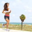 Stock Photo: Healthy young woman jogging on a walkway