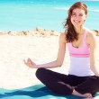 Beautiful young white female doing yoga — Stock Photo