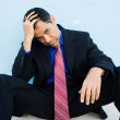Business man sitting down depressed after losing his job — Stock Photo