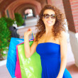 Beautiful Smiling Woman With Shopping Bags Wearing Sunglasses — Stock Photo