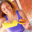Woman Having Mini Burger With Mustard Sauce — Stock Photo