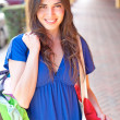 Beautiful young latin girl  with shopping bags smiling — Stock Photo