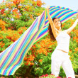 Stock Photo: WomHolding Colorful Striped Cloth