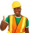 Happy african american construction giving thumbs up — Stock Photo