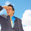 Young Businessman Shielding Eyes — Stock Photo