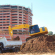 Stock Photo: Excavation Machine Loading Soil In Dumper Truck
