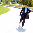 Stock Photo: BusinessmRollerblading In Urgency