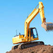 Excavation Machine On Heap Of Soil — Stock Photo
