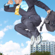 Businessman Rollerblading With Briefcase — Stock Photo