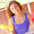 Young Woman Holding Sauce Bottles — Stockfoto