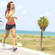 Healthy young woman jogging on a walkway — Stock Photo #29921939