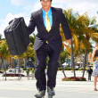 Stock Photo: BusinessmRollerblading At Park