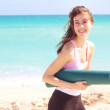 Beautiful young white female holding yoga mat — Foto de Stock