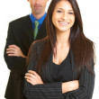 Happy confident young businesswoman with male colleague — Stock Photo