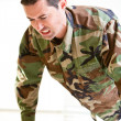White male in army uniform straining doing a push up — Stock Photo