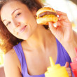Pretty Woman Having Mini Hamburger — Stock Photo #29922399