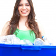 Happy beautiful hispanic female holding recycling bin — Stock Photo