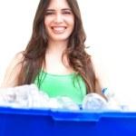 Happy beautiful hispanic female holding recycling bin — Stock Photo #29922421