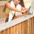 Cute young hispanic girl stretching on boardwalk — Stock Photo